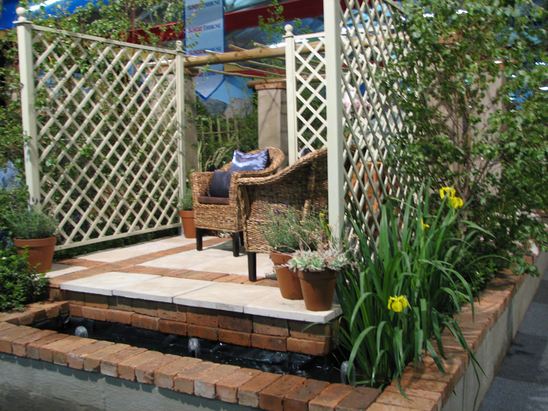 2007 Garden  & Leisure Show. English inspired garden with Iris pseudocorus in a rill. Won Gold
