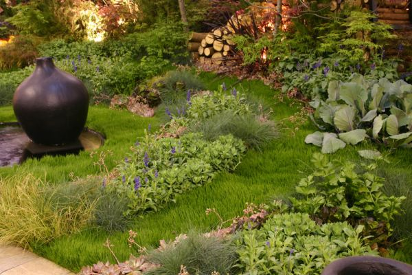 The concentric circles of grasses, herbs and perennials was a last minute improvisation
