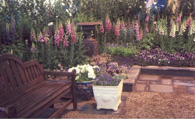 2004 Garden & Leisure Show.Foxgloves, Delphiniums, Lupins, Violas, Pansies, cast iron urns, grave