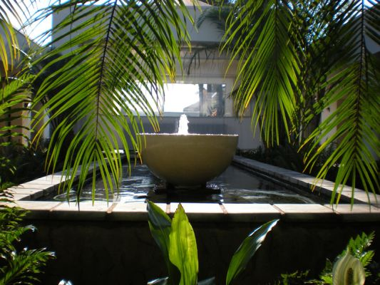 This large, formal raised pond features three Windsor Bowls in glass reinforced concrete from Wilson Stone