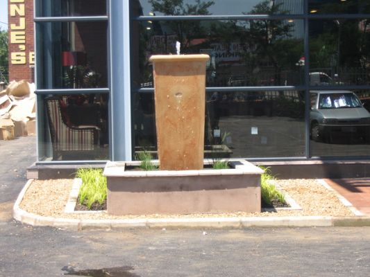 A tall fibre cement pot is the central feature for this water feature at Weatherly's in Pietermaritzburg