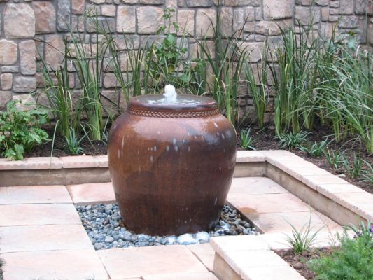 Black clay overburnt pot is a reliable and much sought after addition for a water feature